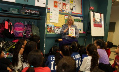 Kimberly Clark read to students of Ms. Ta's class. ( Photo by Ross A. Benson)
