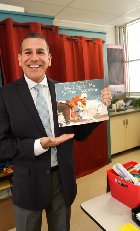 Dr. John Paramo read a classic. (Photo by Ross A. Benson)