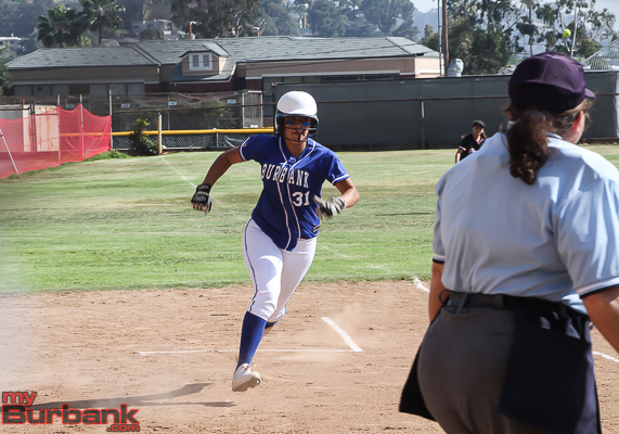 Jazmin Orozco scores the Bulldog's first run (Photo by Ross A. Benson)