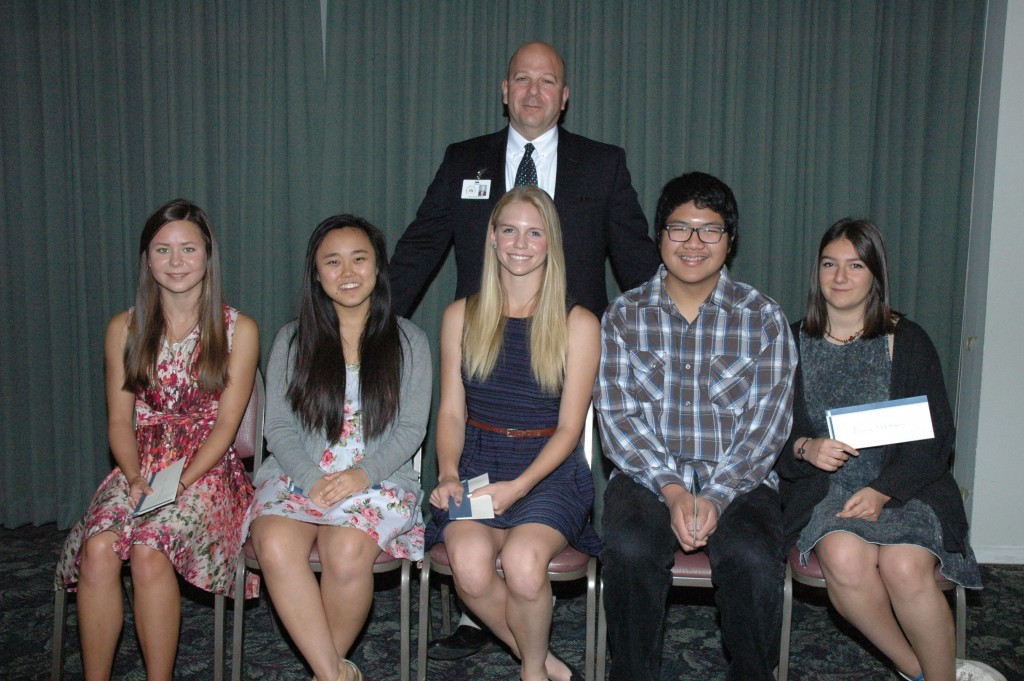 Burbank High School students receiving scholarships from the Burbank Assn. of Realtors' Community Services Foundation are, from left, Madigan Roll, Candace Kim, Julia Newton, Manny Ilasco and Nune Hakobyan with their Principal Michael Bertram.