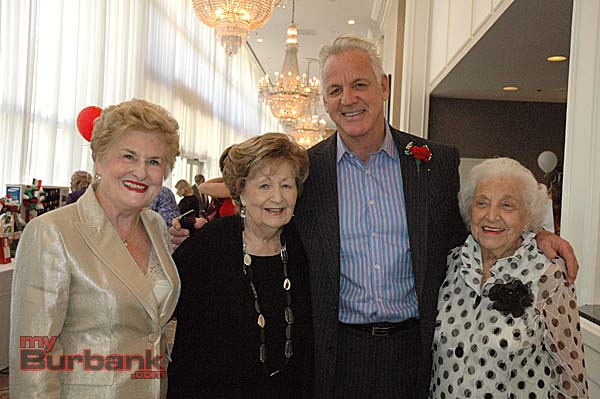 Providence St. Joseph Medical Center Guild officials, from left, Event Director Kathleen Marsden, Second Vice President Terry Campbell and President Ollie Vick welcome master of ceremonies KABC weatherman Garth Kemp to the La Dolce Vita fashion show and luncheon. (Photos by Joyce Rudolph)