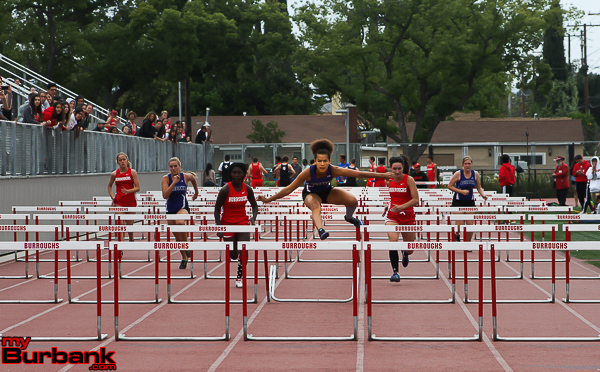 Burbank High's Juliana LaFrance takes 1st place in the Girls 100 Meter Hurdle with Burroughs Breanna McCallum coming in second. (Photo by Ross A. Benson)