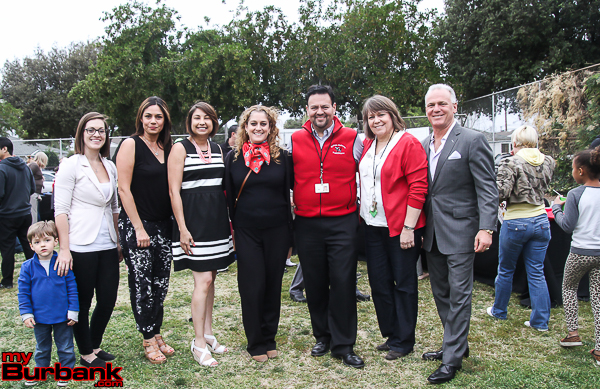 McKinley Community Fair committee members (from left to right): Ashley Shinn (with son Aiden), Sandra Johnson, Principal Liz Costella, Nuria Lundberg, Juan Avila, Laura Chambers and Michael Cusumano. (Photo by Ross A. Benson)