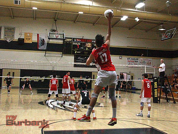 Chamberlain soars high on a serve in the upset win at Oak Park (Photo by Dick Dornan)