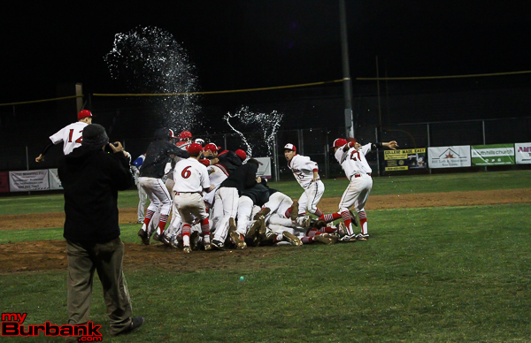 Another victory; another dogpile (Photo by Ross A. Benson)