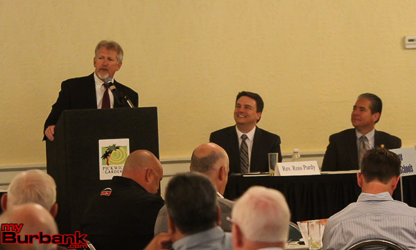 Guest Speaker Bruce Osgood speaking at this years Mayor Prayer Breakfast as Pastor Ross Purdy and Mayor Bob Frutos listen in ( Photo by Ross A. Benson)