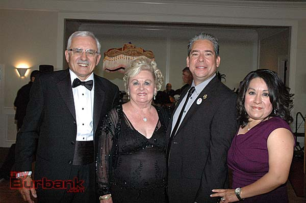 Chris Gargaro and Joan Chandler, left, welcome Burbank Mayor Bob Frutos and his wife, Laura.