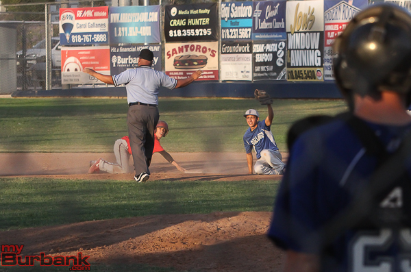Burroughs' Tanner Whitlock slides in safely for a double ahead of the tag by Ky Tanner of Burbank (Photo by © Ross A. Benson)