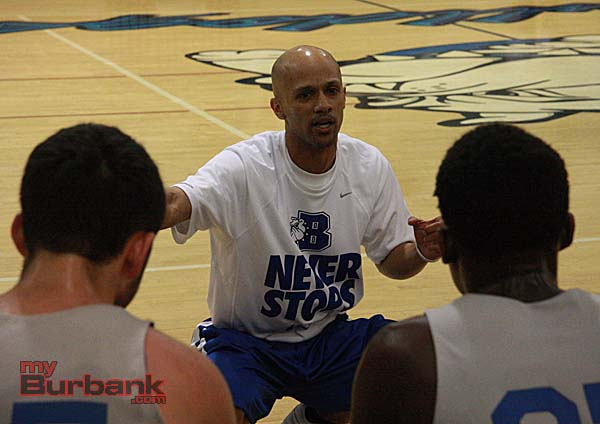 Coach Jamayne Potts instructs his team during a timeout (Photo by Dick Dornan)