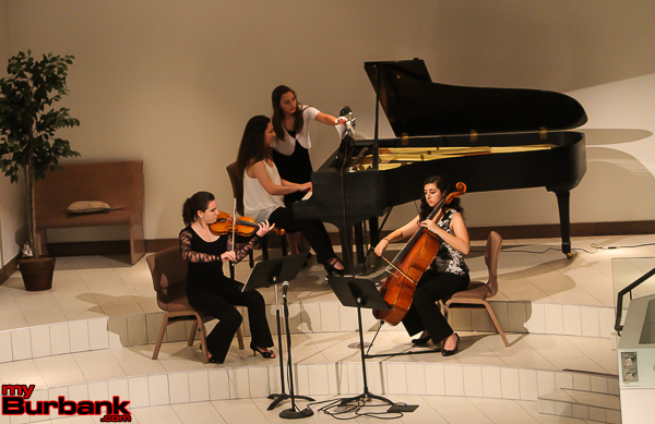 "UCLA violinist Sarah Worden, Burroughs sophomore Maya Paredes (piano) and Chaminade junior Veronica Mansour (cello) perform the exquisite Rachmaninoff ""Piano Trio No. 1 Elegiaque."" Jordan student Eyen Paredes turns pages. (Photo by © Ross A. Benson)"