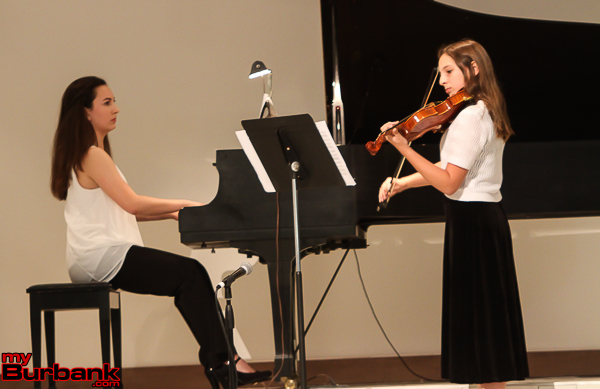 "Maya Paredes and Eyen Paredes (violin) perform Piazzolla's ""Oblivion.""(Photo by © Ross A. Benson)"