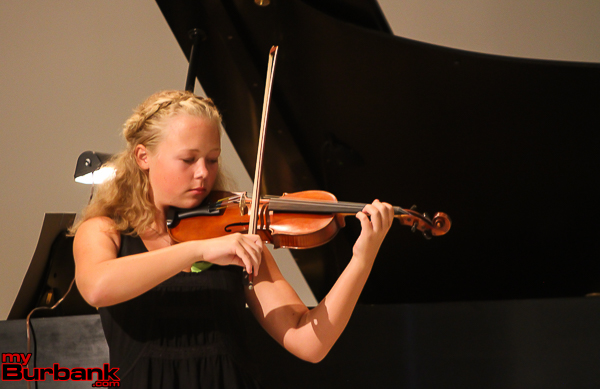 Ella Jennings performs a Seitz violin concerto. (Photo by © Ross A. Benson)