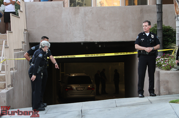 Burbank Police gather evidence at scene of tragic accident involving a 3 year old female. (Photo by © Ross A. Benson)