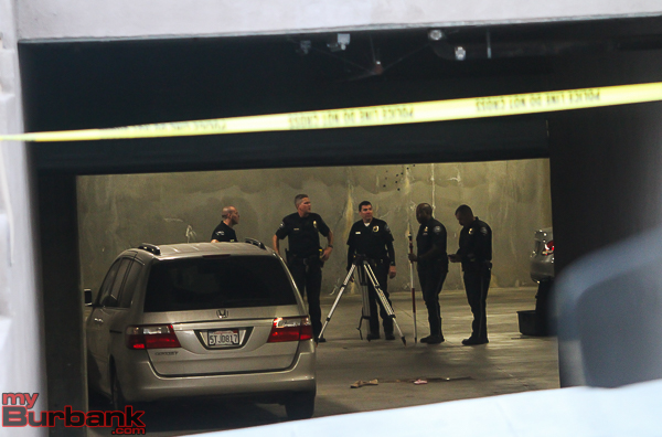 Burbank Police Traffic Officers along with Traffic Investigators gather evidence and photograph scene where a 3 year old female was struck. ( Photo by © Ross A. Benson)