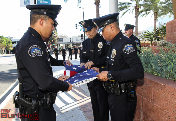 Burbank Police Officer Honor Guard members Officers Lin, Markey, Roberts and Chang.  Detective Burke. fold the U.S. Flag in memory of Harry Strickland (Photo by © Ross A. Benson)