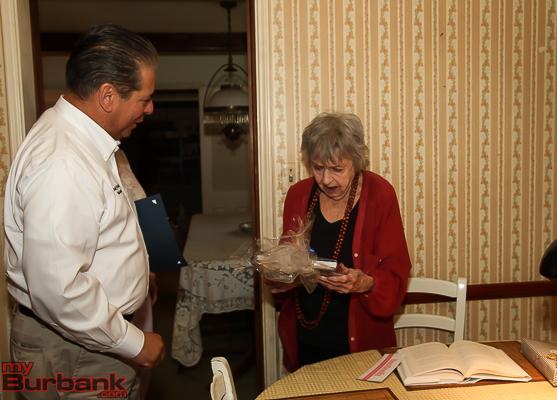 Burbank Mayor Bob Frutos presents Leora Wilson with gifts.  ( Photo by © Ross A. Benson)