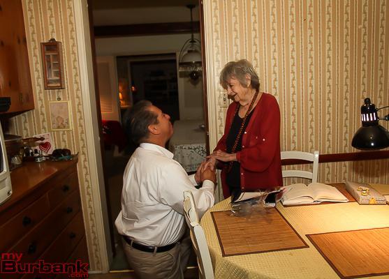 Burbank Mayor Bob Frutos gets on his knee to sing Happy Birthday to Leora Wilson. ( Photo by © Ross A. Benson)