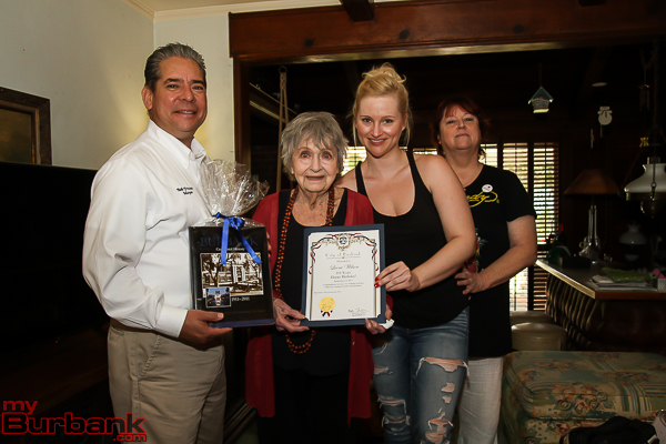 Burbank Mayor Bob Frutos presents Leora Wilson with gifts while posing for pictures with 3 generations including her granddaughter Jessica Leggewie and daughter Diane Leggewie( Photo by © Ross A. Benson)