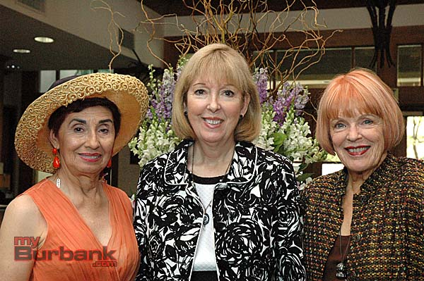 Fashion coordinators Rosemarie Witten, left, and Sue Ann Gordon, right, welcome Suzanne Lapis, director of associates and affiliates at Children's Hospital Los Angeles.