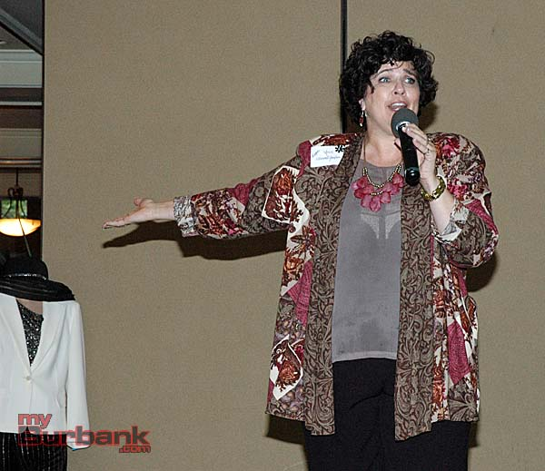 """Summer Meeting Chair and mistress of ceremonies Ann O'Donnell-Gardner sings """"Everything Old is New Again""""."""
