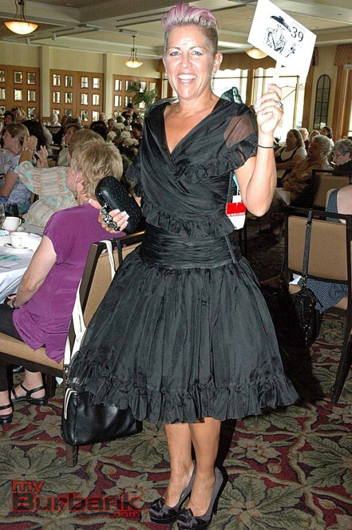 Sandra Kelley did double duty at the Summer Meeting. She was a model and coordinated the silent auction.