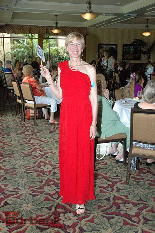 A fashion show highlight was a ruby gown fit for the red carpet shown by Jill Kessler, who has just joined the guild.