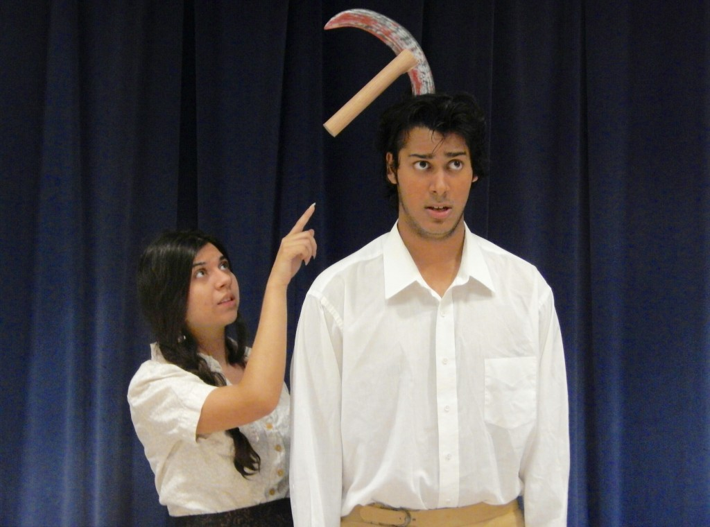 "Twelfth-graders Chelsy Cordon Rojas and Vicktor Aggerwhil examine ""Variations on the Death of Trotsky"" for Burbank High's performance of ""All In The Timing."" (Photo Courtesy Burbank High School Drama Dept.)"