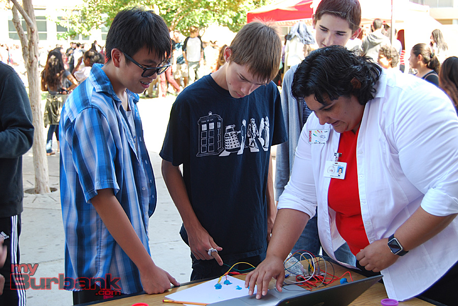 Teacher Debbie McHorney demonstrates some functions of the Makey-Makey interactive station at JBHS Arts For All Day. (Photo By Lisa Paredes)