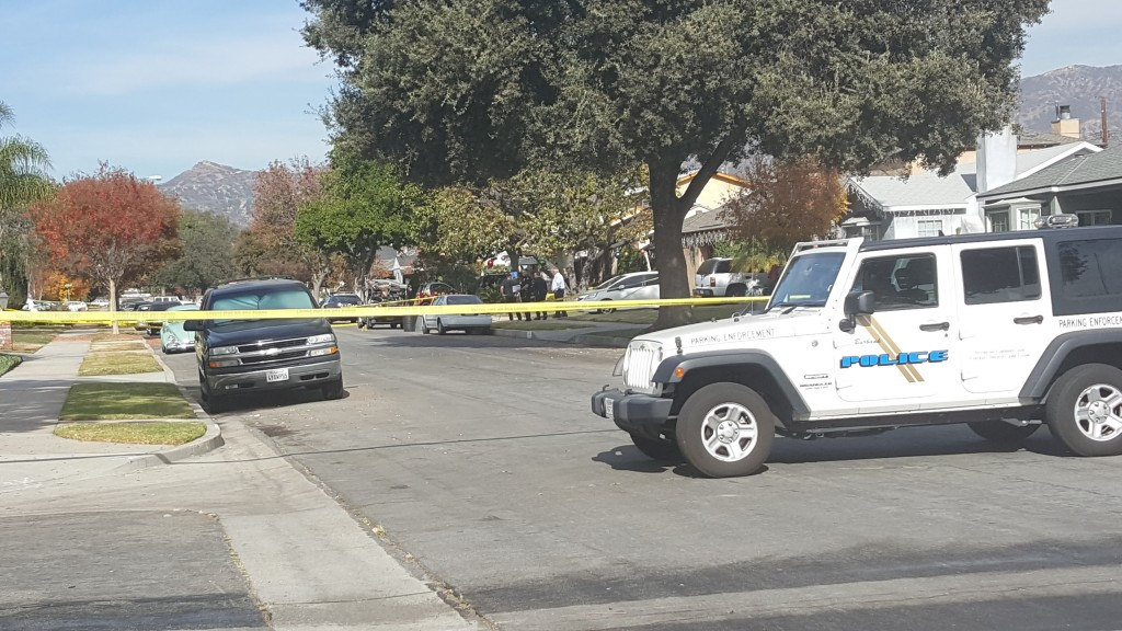 Police look near a gardener truck for evidence after two people were shot by an unknown person (Photo By Ross A. Benson)