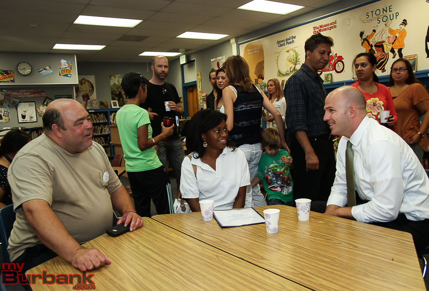Superintendent Matt Hill meets parents on the first day of school, August 17, 2015. (Photo by © Ross A. Benson)