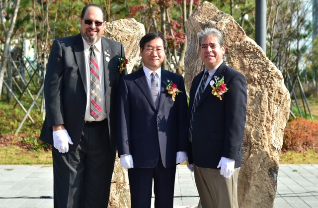 "Burbank Councilman David Gordon, from left, Incheon Mayor Yoo Jeong-bok and Burbank Mayor Bob Frutos at the unveiling ceremony for the new art sculpture ""Dancing Stones"" in Incheon, South Korea. (Photo courtesy Burbank City Council)"