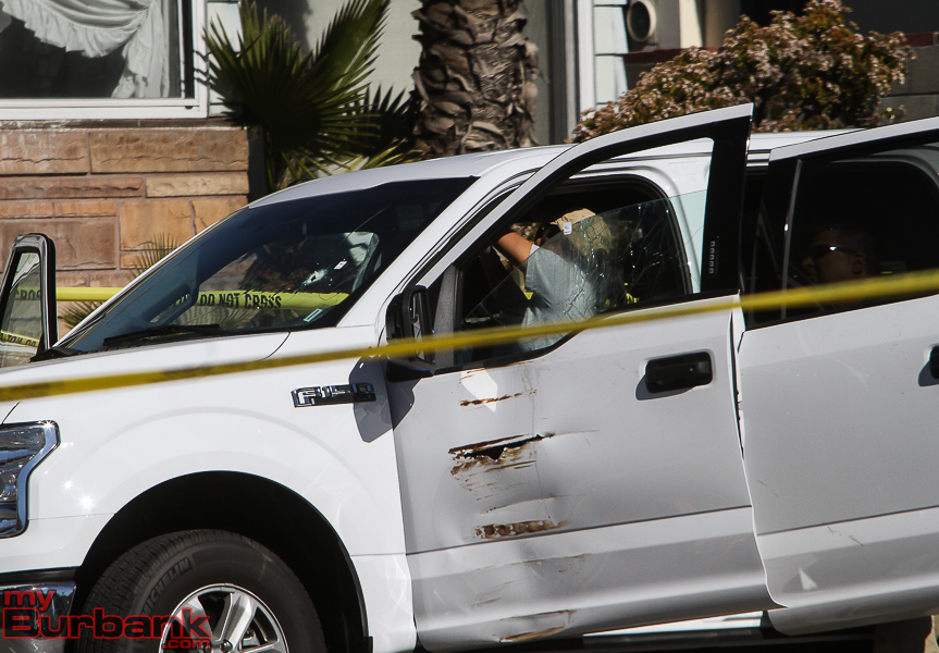 Los Angeles County Sheriff's Department Forensic Identification Specialist gather evidence from suspects vehicle today following a Officer involved shooting.    (Photo by© Ross A. Benson)