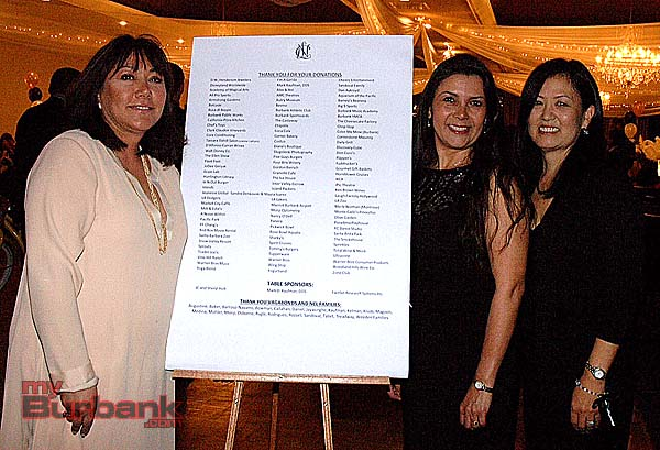 Displaying the National Charity League sponsor list are, from left, event chair Elizabeth Osborne with donation co-chairs Juliet Barroso-Navarro and Judy Monji. (Photos by Joyce Rudolph)