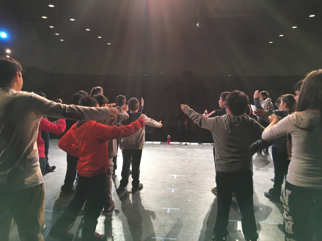 "Students from John Muir Middle School rehearse ""Homeland: Poetry in Performance."" (Photo Courtesy of Jessica Wertlieb)"
