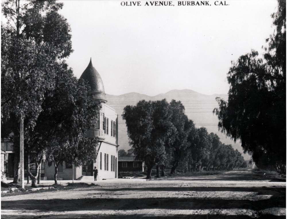Brick Block-Looking up Olive Ave. Note all the pepper trees 1908