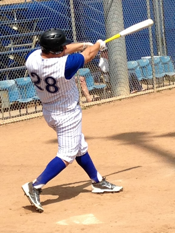 Danny Porras hits a long single off the right field fence at Burbank High.