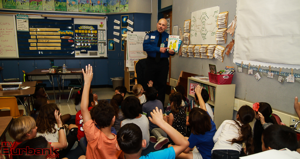 TSA Agent Stu Megaw  read to a class at Bret Harte.  (Photo by © Ross A. Benson)