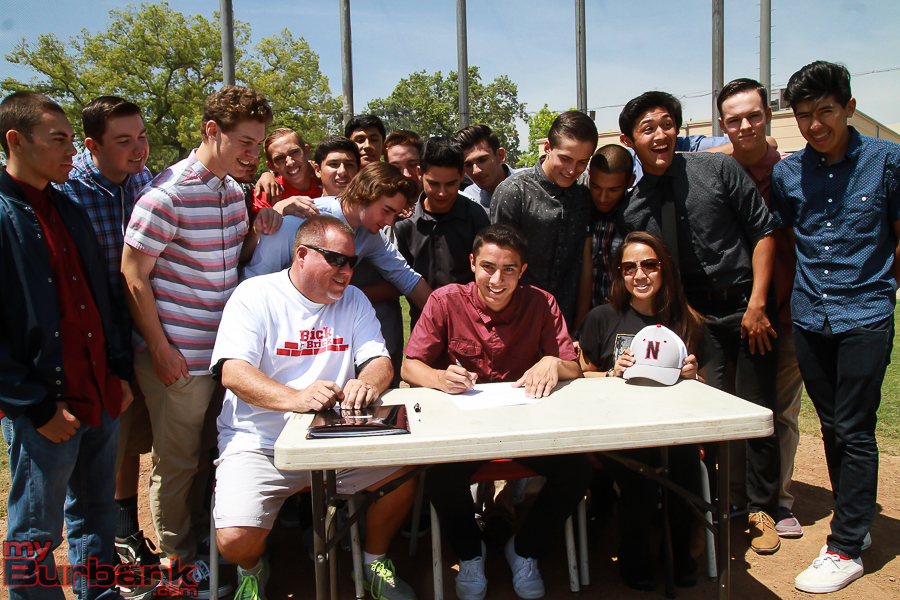 The signing was held on top of the mound on the Burroughs baseball field (Photo by © Ross A. Benson)