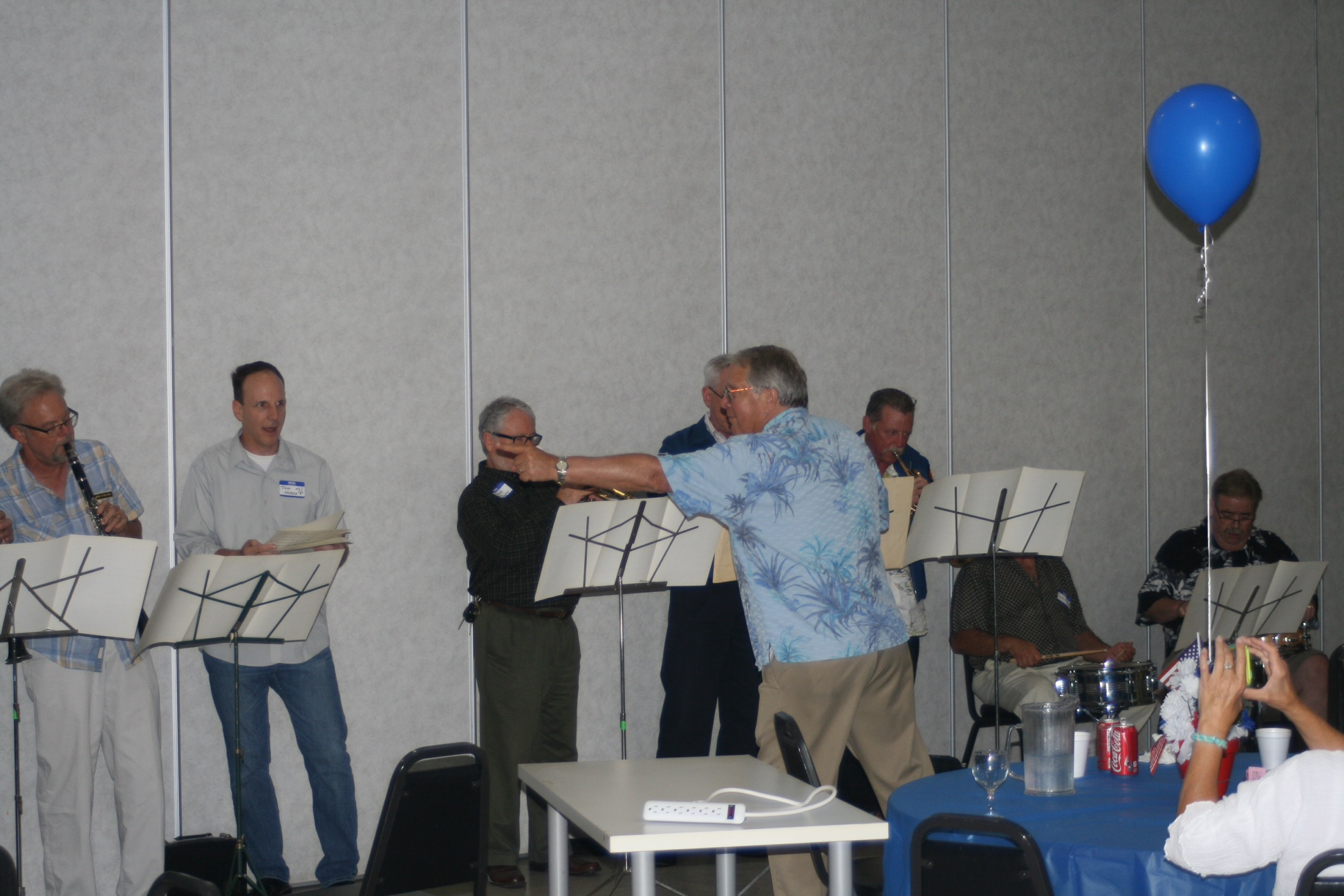 """Director Bill Kuzma leads the alumni members in the group's signature song """"South Rampart Street Parade"""". (Courtesy Joanne Lento Miller)"""