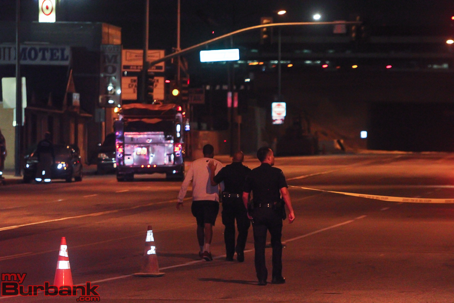 Burbank Police Console the brother of the victim when he showed up at the shooting scene. (Photo by © Ross A. Benson)