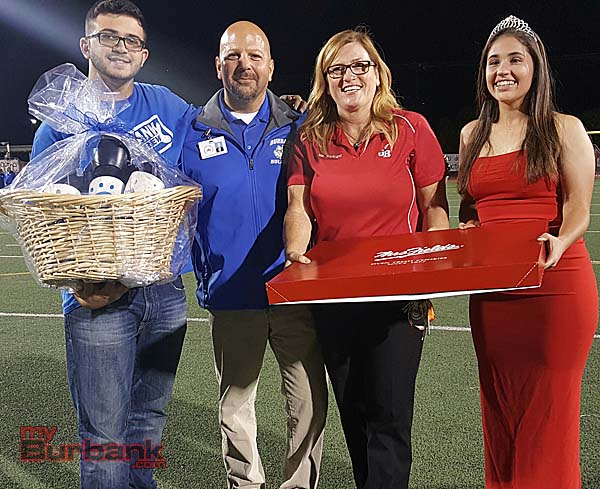 Principals Dr. Michael Bertram of Burbank High and Deborah Madrigal of Burroughs along with the ASB Presidents of each school exchanged gifts in the name of sportsmanship before the start of the Big Game (Photo By Ross A. Benson)