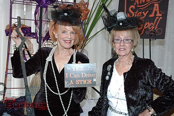 """Scaring up a grand time at """"The Good Witches Fashion Show and Luncheon"""" are La Providencia Guild's Fashion Show Chair Sue Ann Gordon, left, and President Lynn White-Shelby. (Photos by Joyce Rudolph)"""