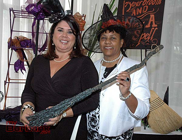 Patricia Taylor, left, lotto bracelet chair, and Glenda Jones, opportunity basket chair, wear their Halloween finery at the fashion show luncheon. (Photos by Joyce Rudolph)