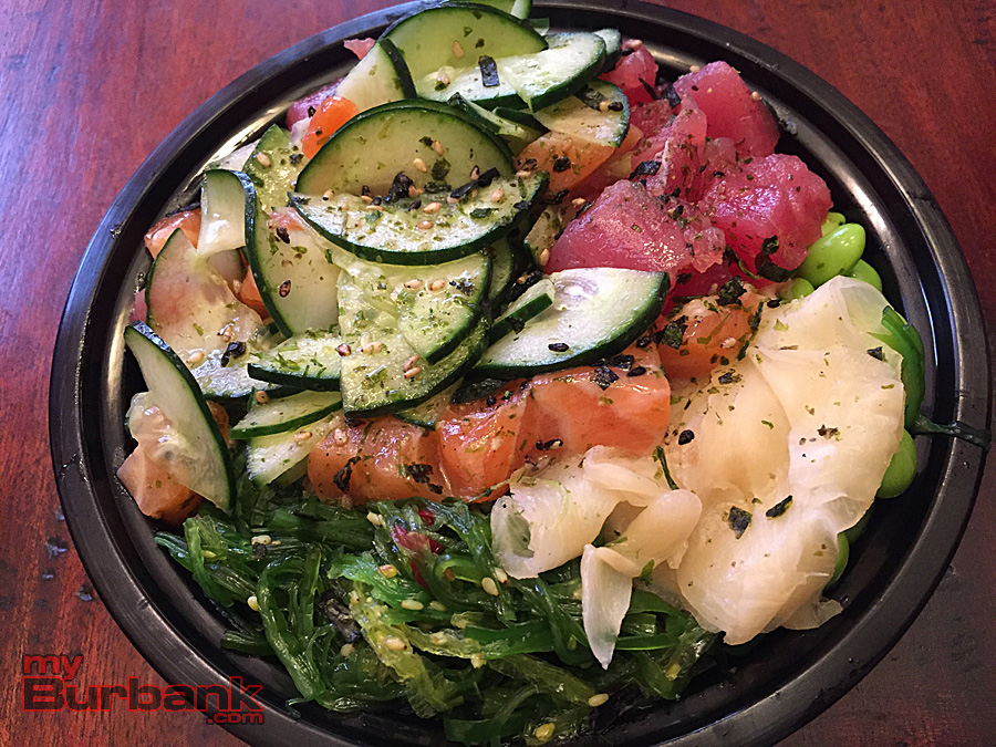 Small All About Poke bowl with salmon, tuna, seaweed salad, vegetables and brown rice. (Photo By Lisa Paredes)