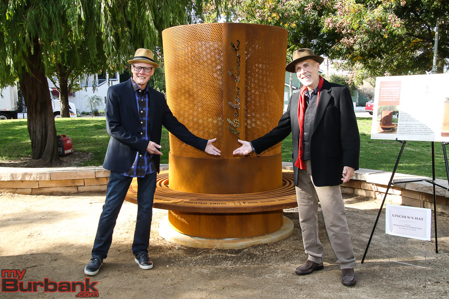 """b9e9d6cc8db Lincoln Park """"The Hats"""" artists Michael Davis (left) and Eugene Daub pose  with """"Lincoln s Hat"""